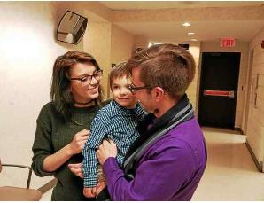 Deserae DiCiesare and Taylor Trupiano play with DiCeisare_s 3-year-old son Landon in the hallway of 39th District Court in Roseville. MITCH HOTTS -- THE MACOMB DAILY